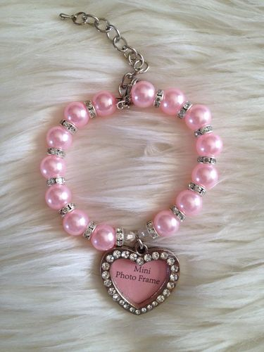 collier perle rose et  porte photo